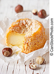 Cheese. - French cheese Lagres with nuts on an old wooden...
