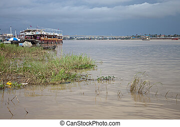 River with tourist boats in Pnom Penh, Cambodia