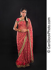 Full body traditional Indian girl in sari costume standing...