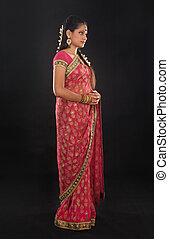 Full body traditional young Indian girl in sari costume...