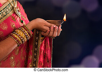 Diwali light - Diwali or deepavali photo with female hands...