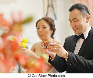Traditional Chinese wedding tea ceremony, bride and groom,...