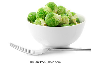 Brussel sprouts in bowl and fork on white background.