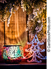 Candlestick. - Christmas candlestick on a wooden background...