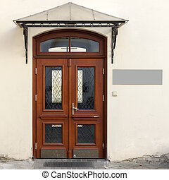 Wooden doors with signage - Old wooden front doors with...