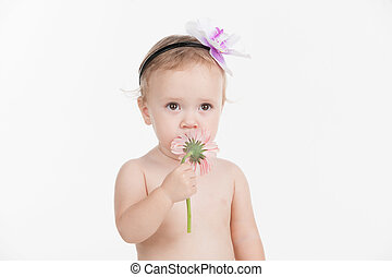 Portrait of little cut baby girl with beautiful flower...