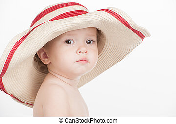 Portrait of Beautiful little baby girl in summer hat....