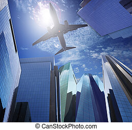 passenger plane flying ove rmodern office building against...