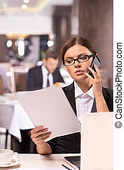 Businesswoman at work. Thoughtful young woman in formalwear...
