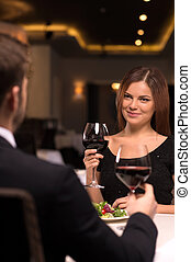 Couple at the restaurant. Beautiful young couple drinking...