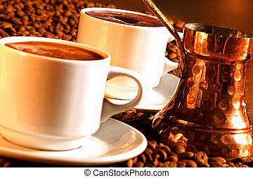 Two cups of turkish coffee with pot