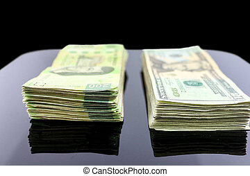 Money on the table - A bunch of mexican pesos bills...