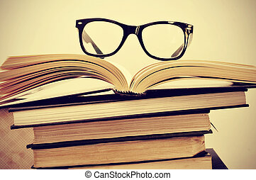 books and eyeglasses - picture of a pile of books and...