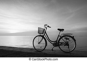 Bicycle - Silhouette of a bicycle on the beach at dusk.