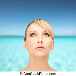 beautiful woman looking up - health, spa, beauty and...