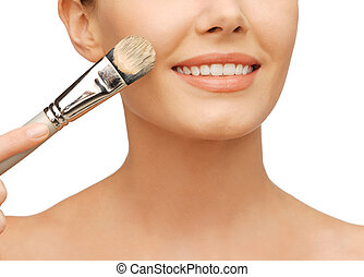 beautiful woman with brush - beauty amd make-up concept -...