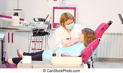 female dentist and little girl