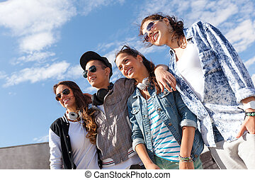 smiling teenagers in sunglasses hanging outside - summer...