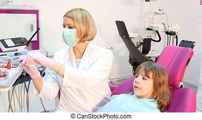 female dentist examines teeth