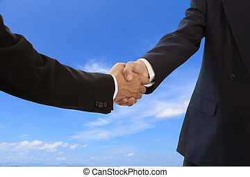 Businessman handshake on blue sky