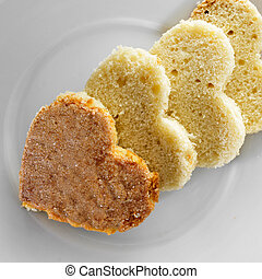heart-shaped sponge cake - closeup of some heart-shaped...