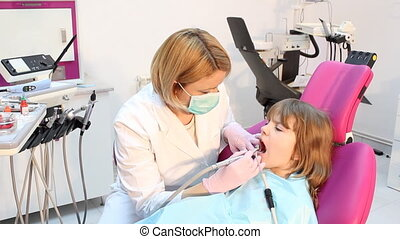 little girl and female dentist