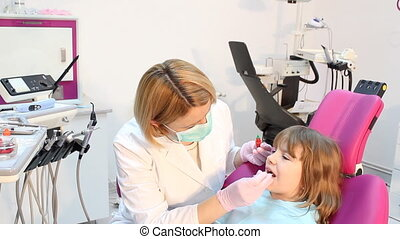 Little girl in the dentists office
