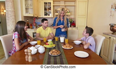 Breakfast - Family of four having a delicious breakfast