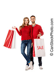 shopping happiness - Happy young couple standing with a lot...