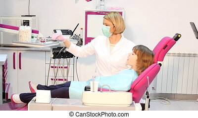 little girl with drilling treatment