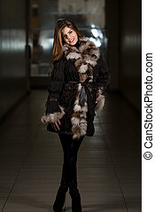 Fashion Girl Wearing Snow Jacket In Shopping Mall - Portrait...