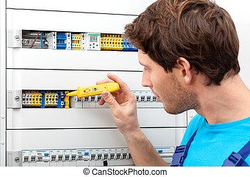 Repairman fixing a switchboard - Repairman checking a...