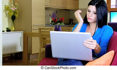 Woman working at home with pc