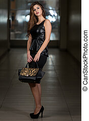 Woman In Black Skirt And Leather Peplum Top - Portrait Of...
