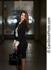 Business Woman In Suit At The Shopping Mall - Portrait Of...