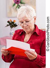 Grandma's birthday card - A grandma reading a red birthday...