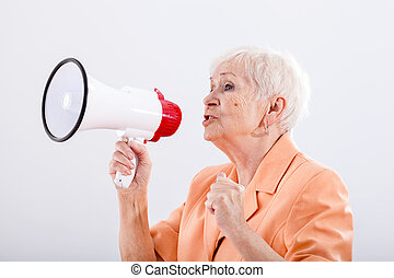 Grandma with megaphone - An elegant grandma talking through...