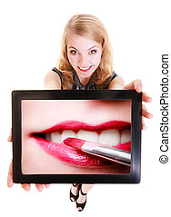 Girl showing ipad tablet touchpad with photo of lips...