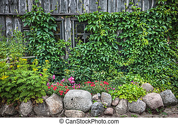 cottage and stone wall with flowers