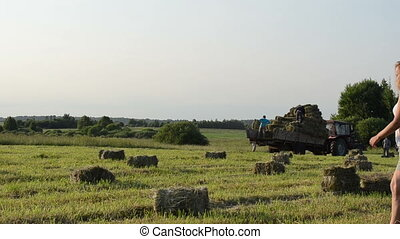 woman carry bale tractor - Pretty young farmer woman girl...