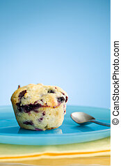 Muffin and blue plate - Close up of blueberry muffin on the...