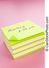 Sticky notes - Pile of sticky notes with meeting reminder...