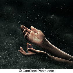 Female hands on stormy sky - Extended female hands on stormy...