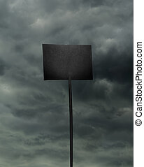 Black board on stormy sky