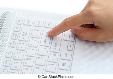 finger pushing the button of keyboard - finger pushing the...