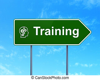 Education concept: Training and Head With Gears on road sign background