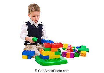 Playing kid - 4 years old boy playing with building blocks