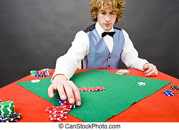 Poker pay out - A dealer paying out a player after a winning...