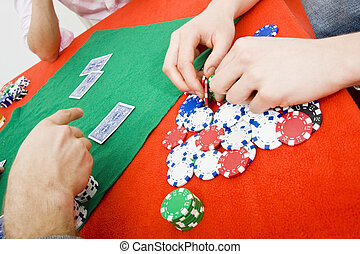 Poker game - Details of a poker game with a player grabbing...