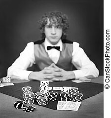 Face the dealer - A poker player facing the dealer over a...